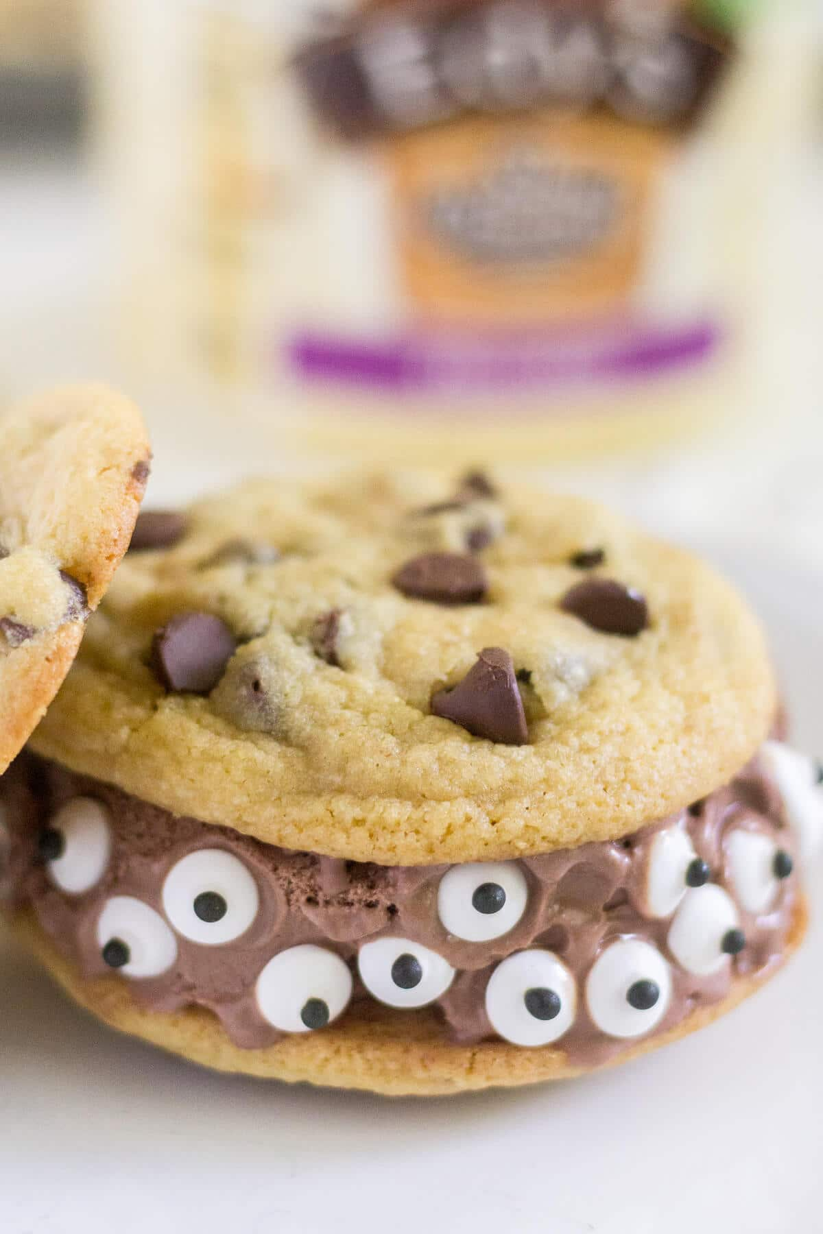 Spooky Monster Ice Cream Sandwiches are an easy Halloween treat for kids and adults alike! This Halloween recipe is a fun dessert for any spooky occasion, from a kid's party to a trick-or-treating night in.