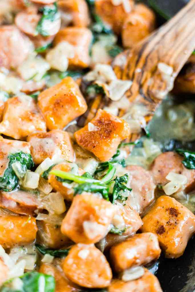 sweet potato gnocchi served with a spinach cream sauce