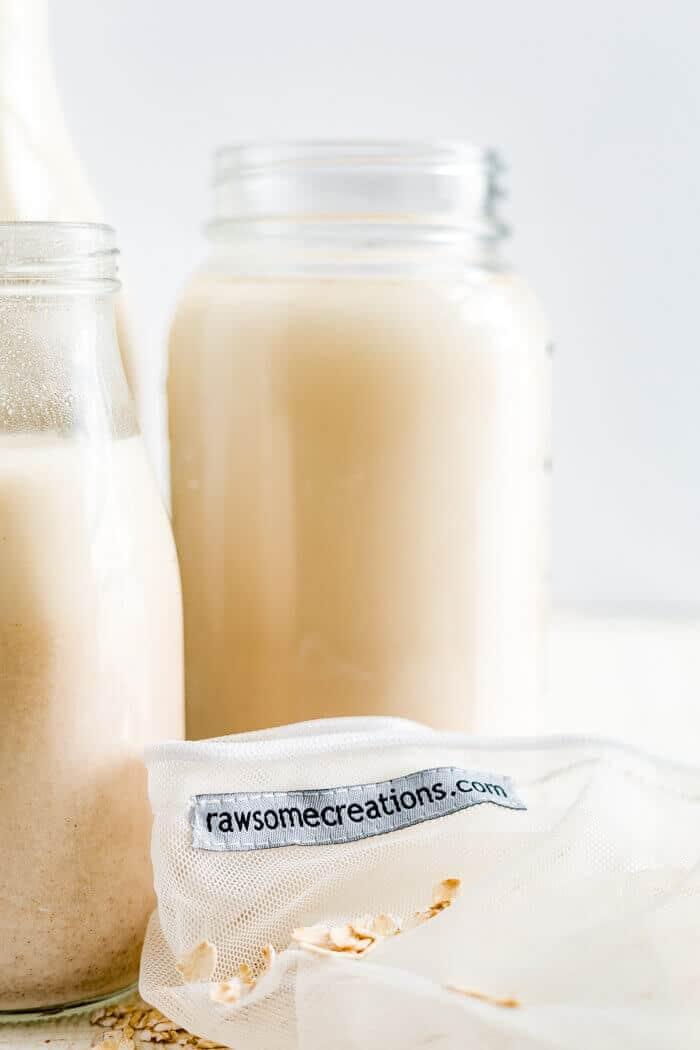 jar of oat milk with a nut milk bag