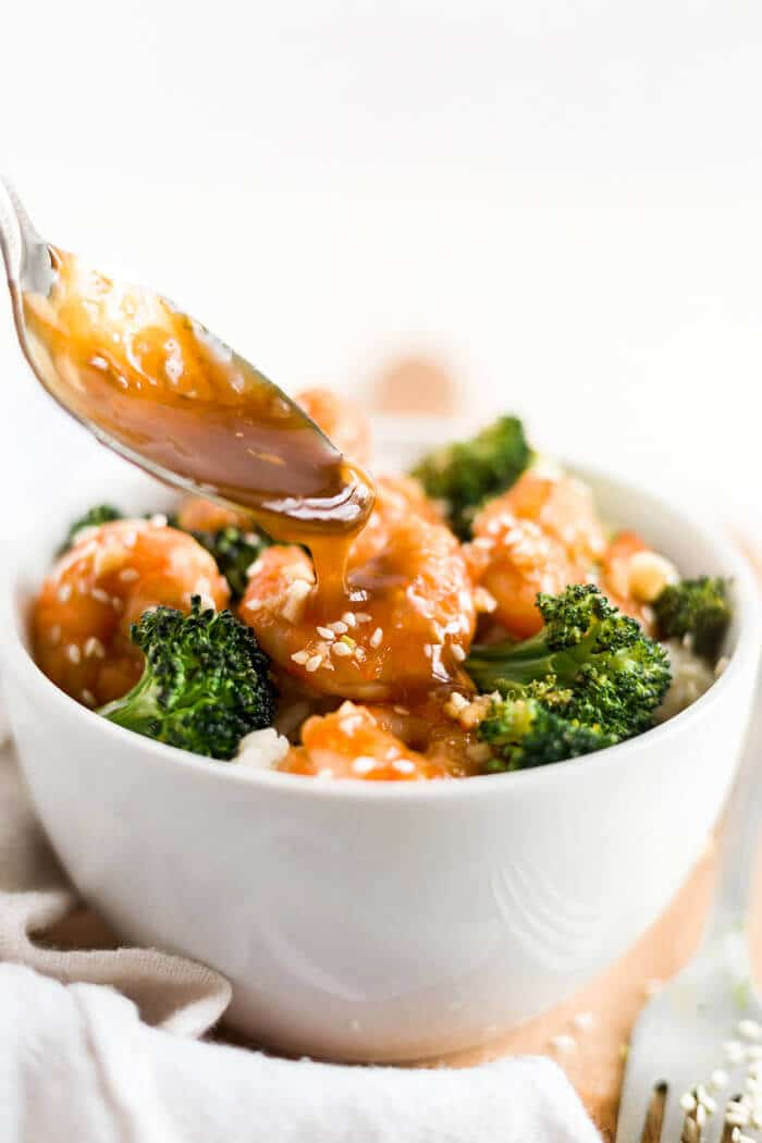honey garlic shrimp in a bowl with rice and broccoli