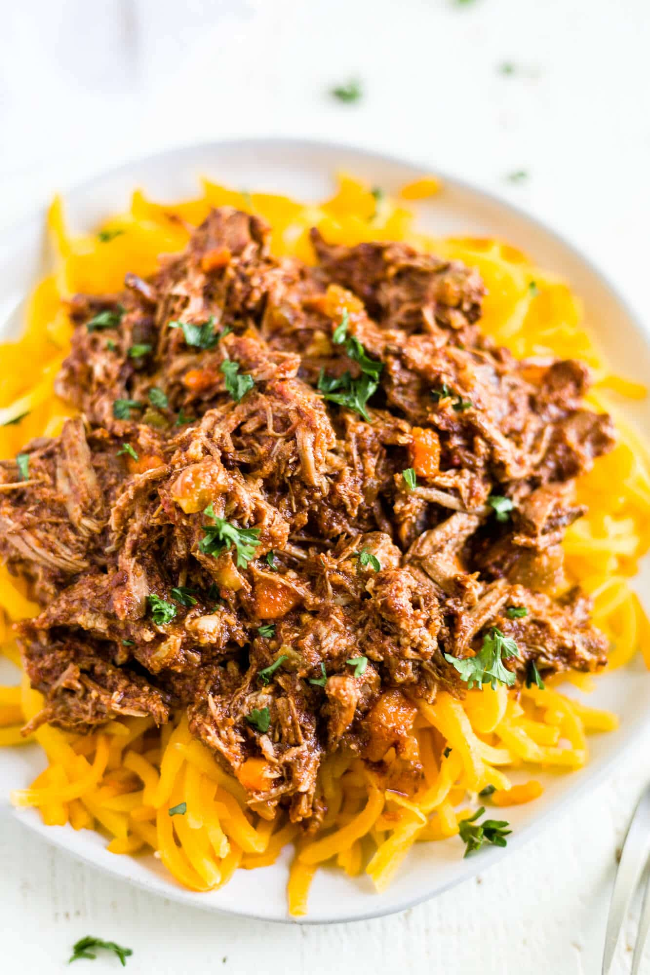 braised beef ragu on top of butternut squash noodles to make it a whole30 recipe