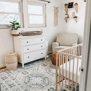 picture of neutral boho nursery with natural wood crib, white dresser and boho accents