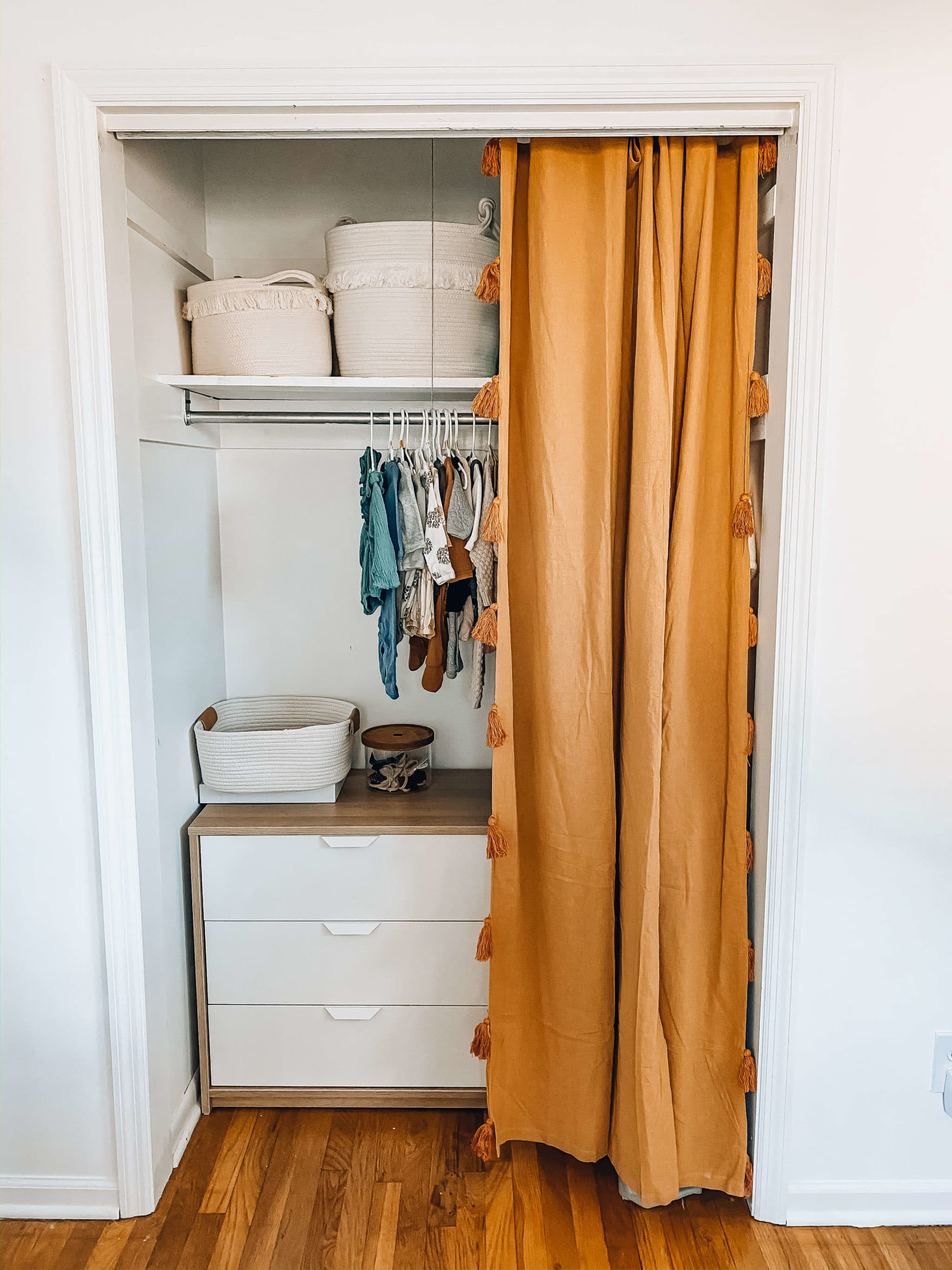 neutral boho nursery closet organization