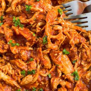 bbq pulled chicken in a dish with two forks