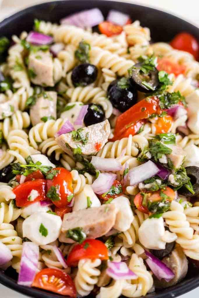 italian pasta salad recipe including pasta, peppers, sausage, mozzarella and italian dressing