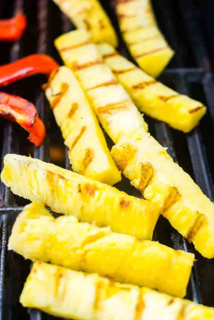 pineapples spears on the grates with grill marks