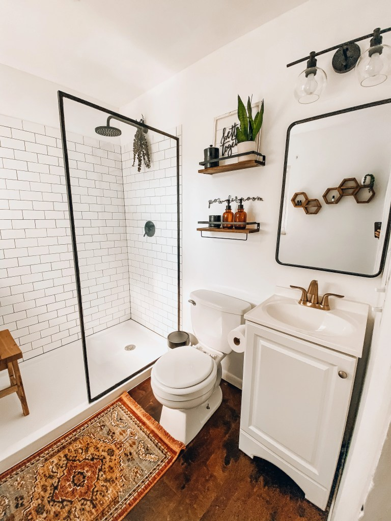 modern farmhouse bathroom remodel with subway tile shower and plants
