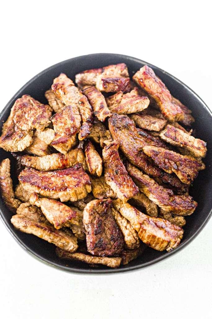 crispy brown flank steak cut into slices for stir fry