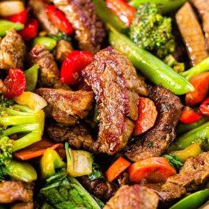 close up of crispy steak stir fry with vegetables