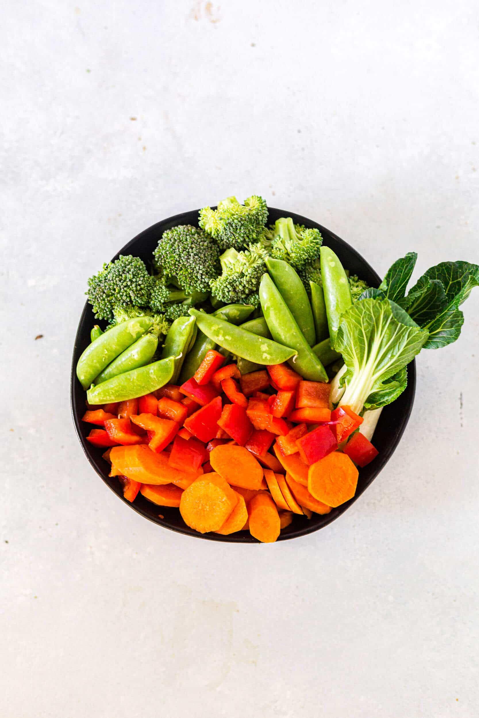 stir fry vegetables in a black bowl