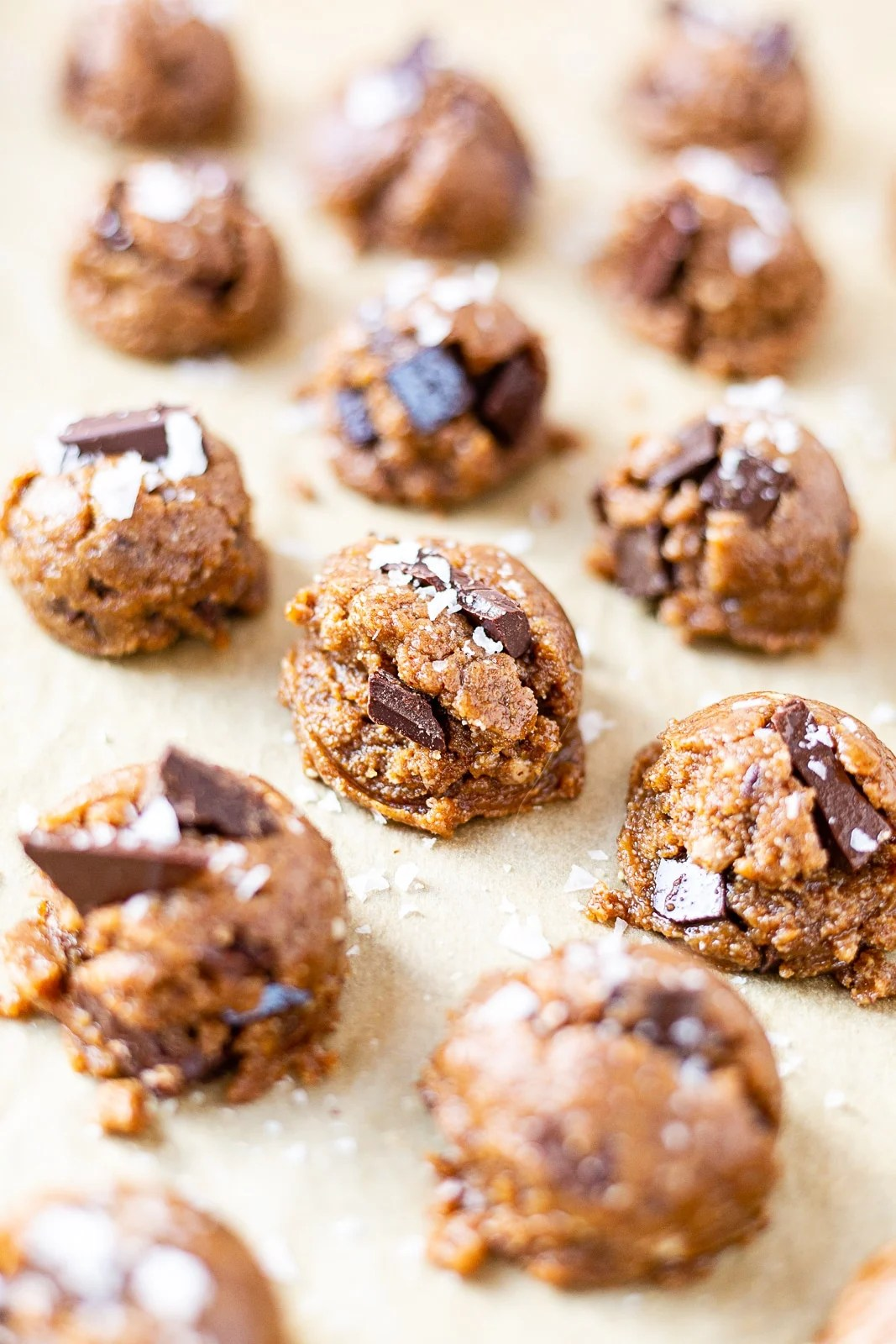 almond butter chocolate chip cookie dough on a baking sheet
