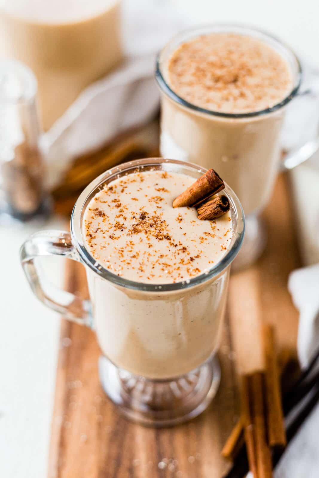 spiced dairy free eggnog recipe topped with fresh nutmeg