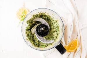 arugula pesto ingredients blended in the food processor