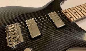 Jednoczęściowa gitara Lassie z włókna węglowego porzuciła wzmacniający pręt