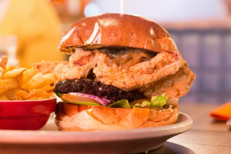 Crispy Black Coq - Southern Fried Chicken Breast with Caramelised Onions, Jack Mac's Black Pudding & Pepper Sauce.