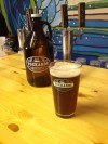 Sampling a glass of the Anglesea Irish Red Ale.