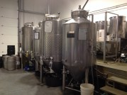 Fermenting tanks lined up in the middle of the room.
