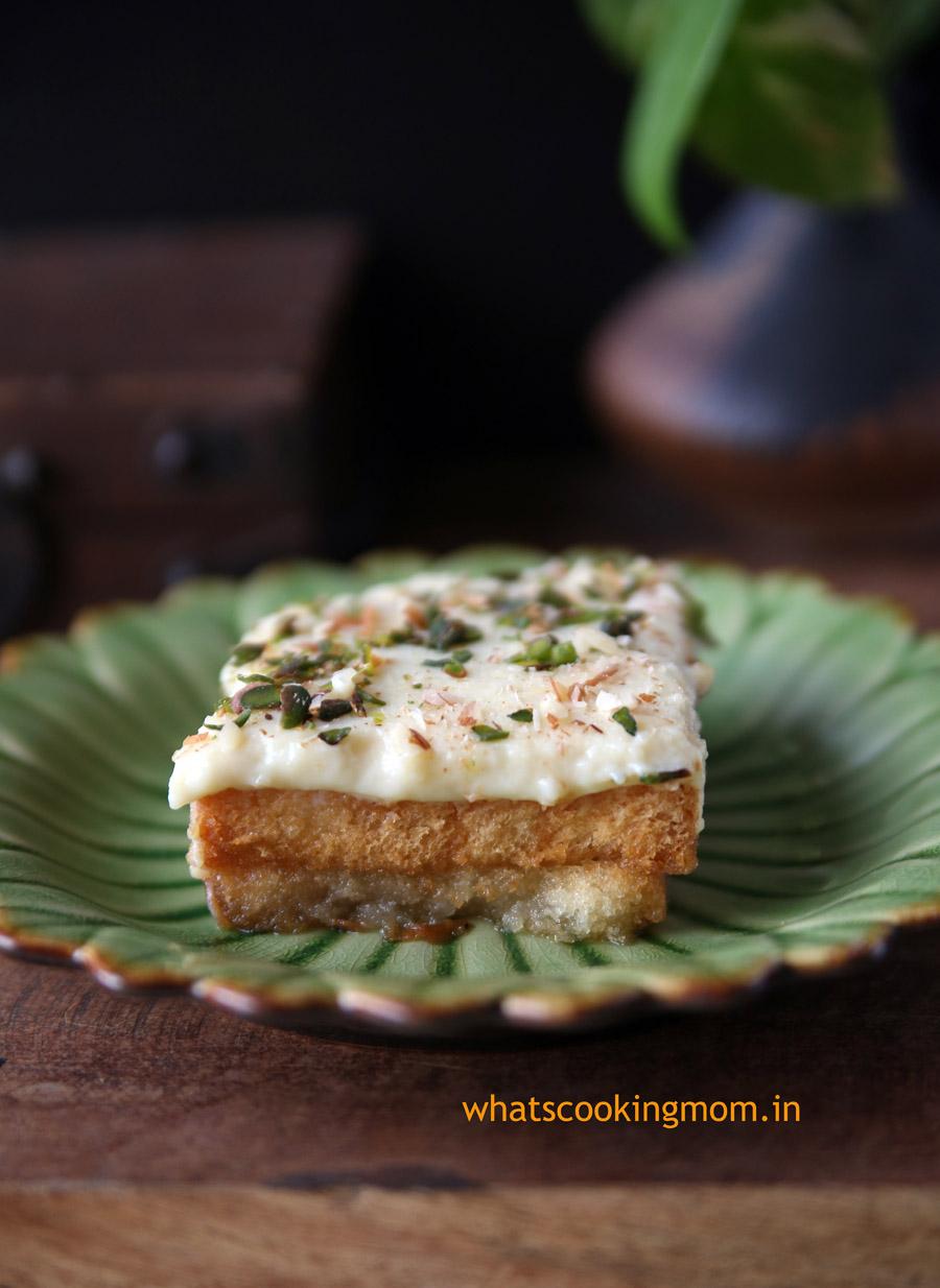 Aish el Saraya- mediterranean dessert. made with rusk, sugar syrup and custard pudding | whatscookingmom.in