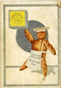man made of dough wearing apron and chef hat