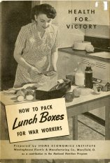 Woman in 1940s kitchen packing lunches