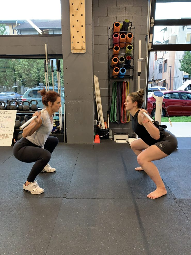 Sam and Emily practicing powerlifting