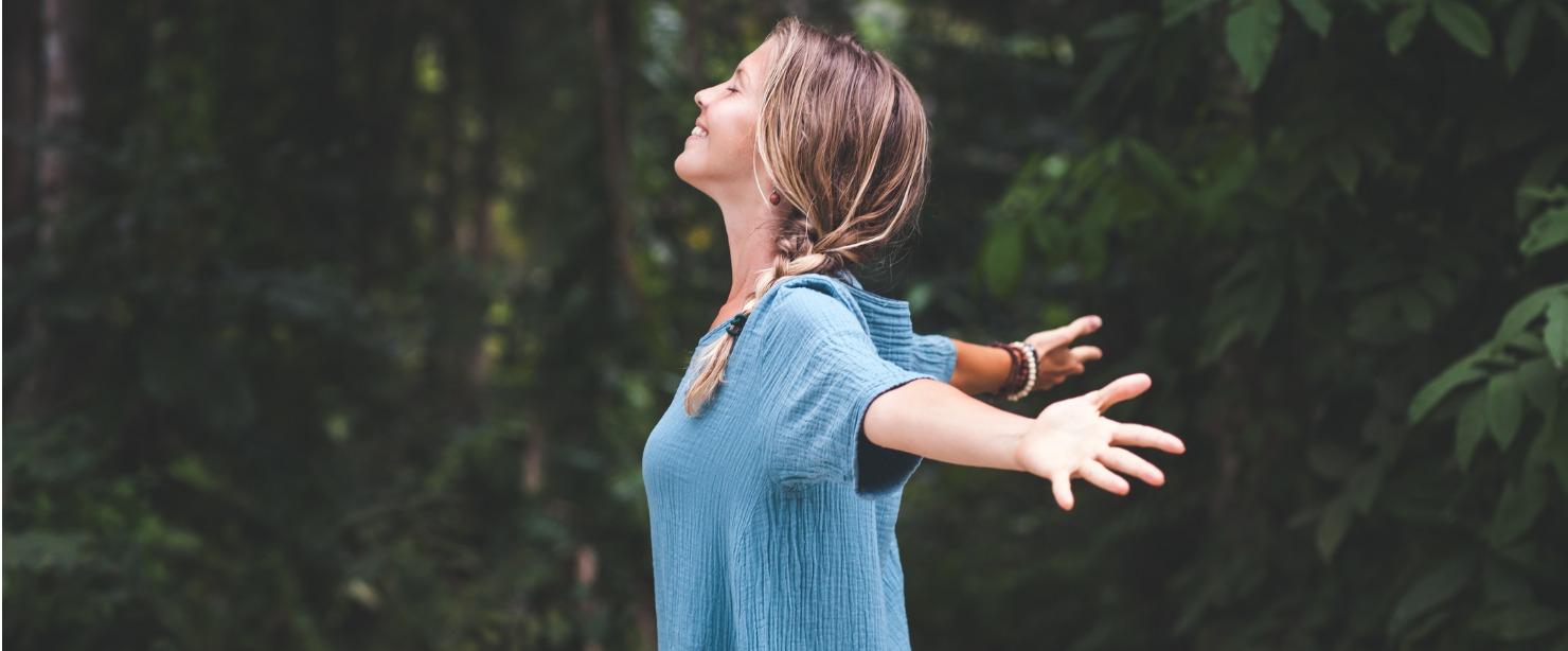 energized woman enjoying nature