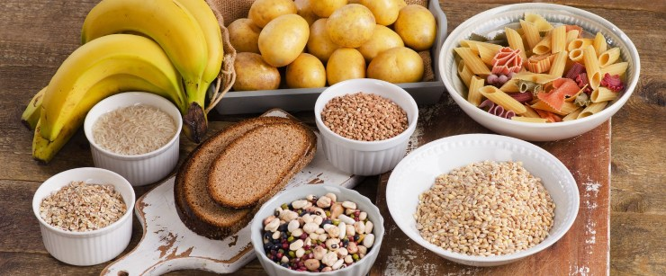 foods high in carbohydrates on wooden background