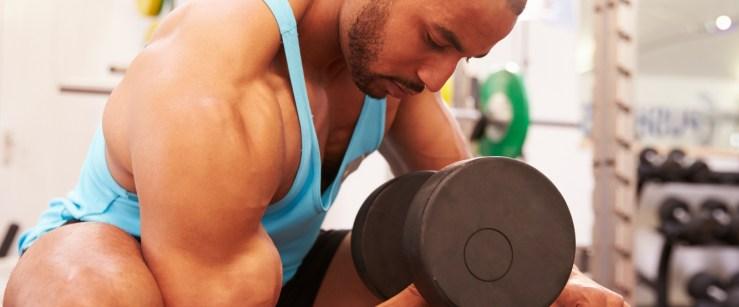 young black man performing biceps curls
