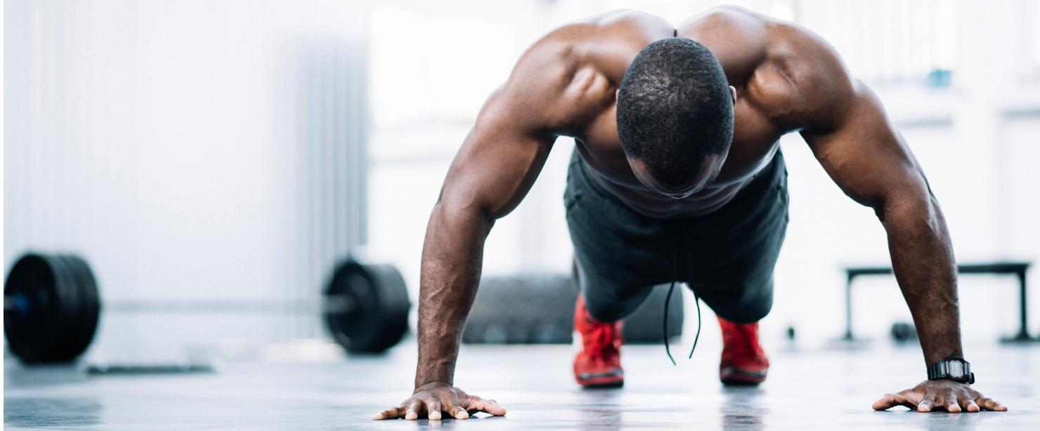 black man doing pushups