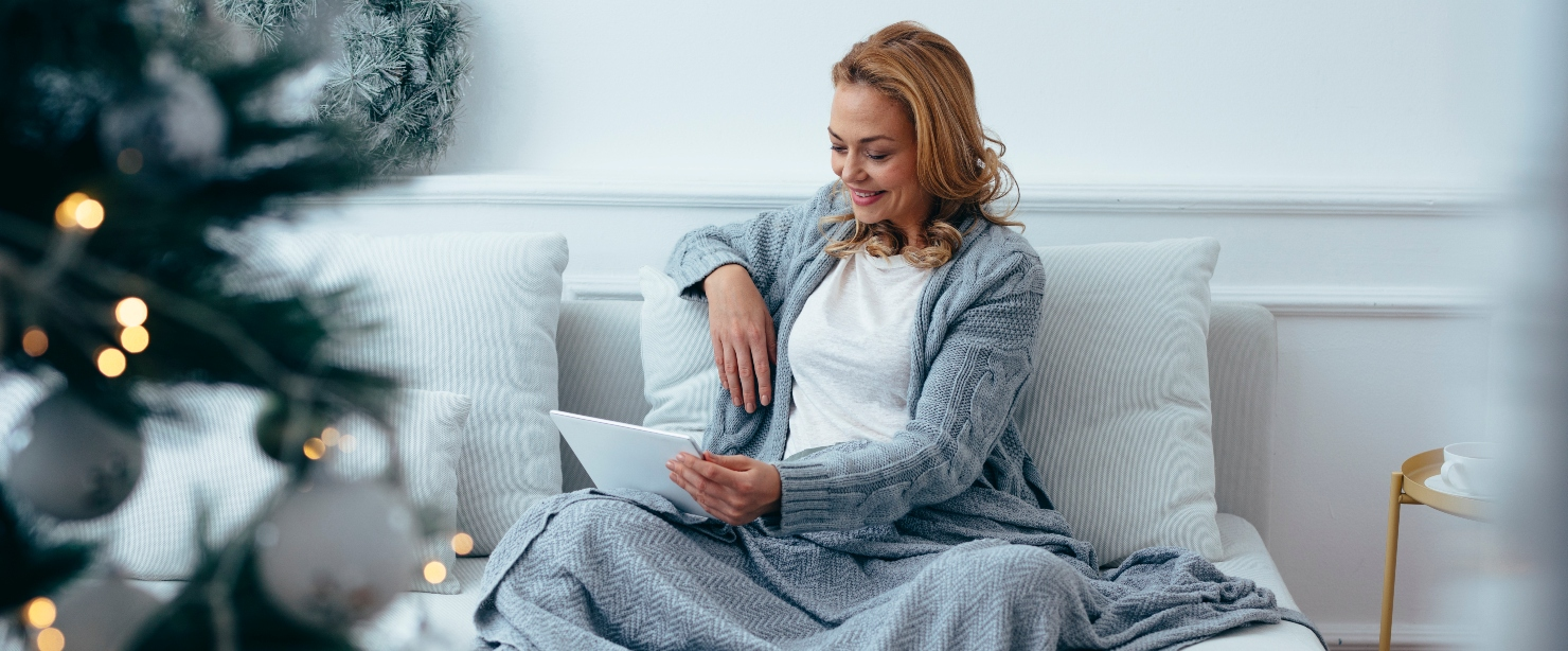 SAD: older woman reading on couch in winter