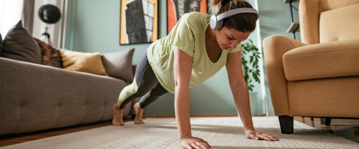 woman doing pushups in living rom