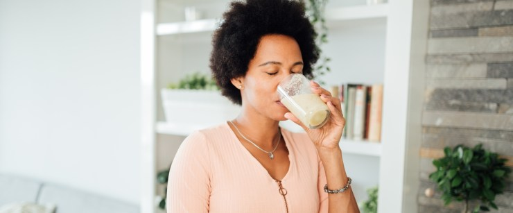 woman drinking healthy shake
