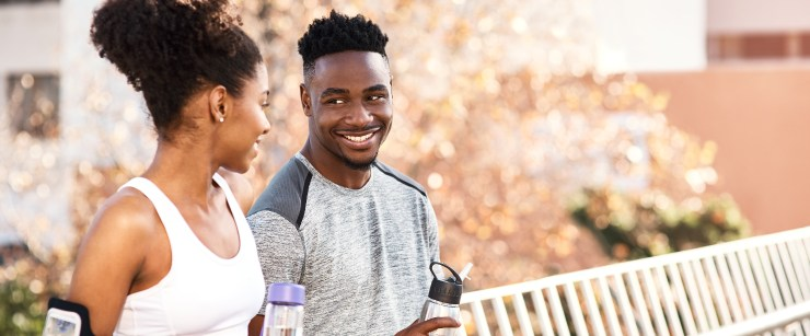 hire a personal trainer: young black couple after exercise outside