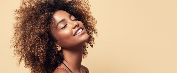 ingredients for dry skin: young black woman smiling
