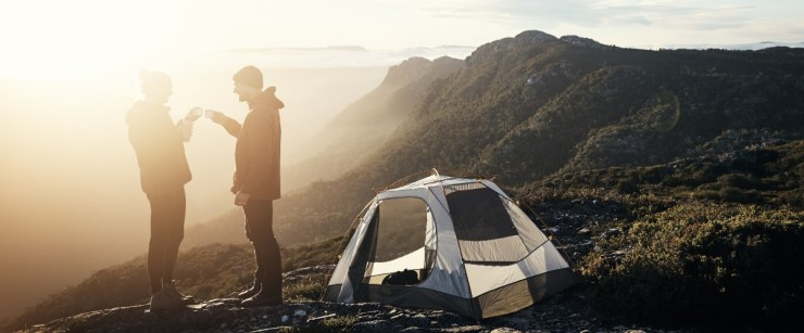 reset your circadian rhythm: campers drinking coffee outside in the morning