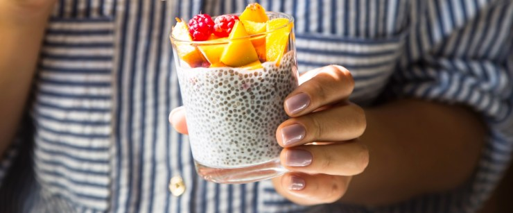 get more omega-3s: hand holding chia pudding