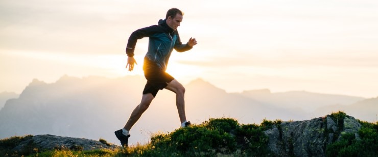 protect your joints: man trail running on mountain top