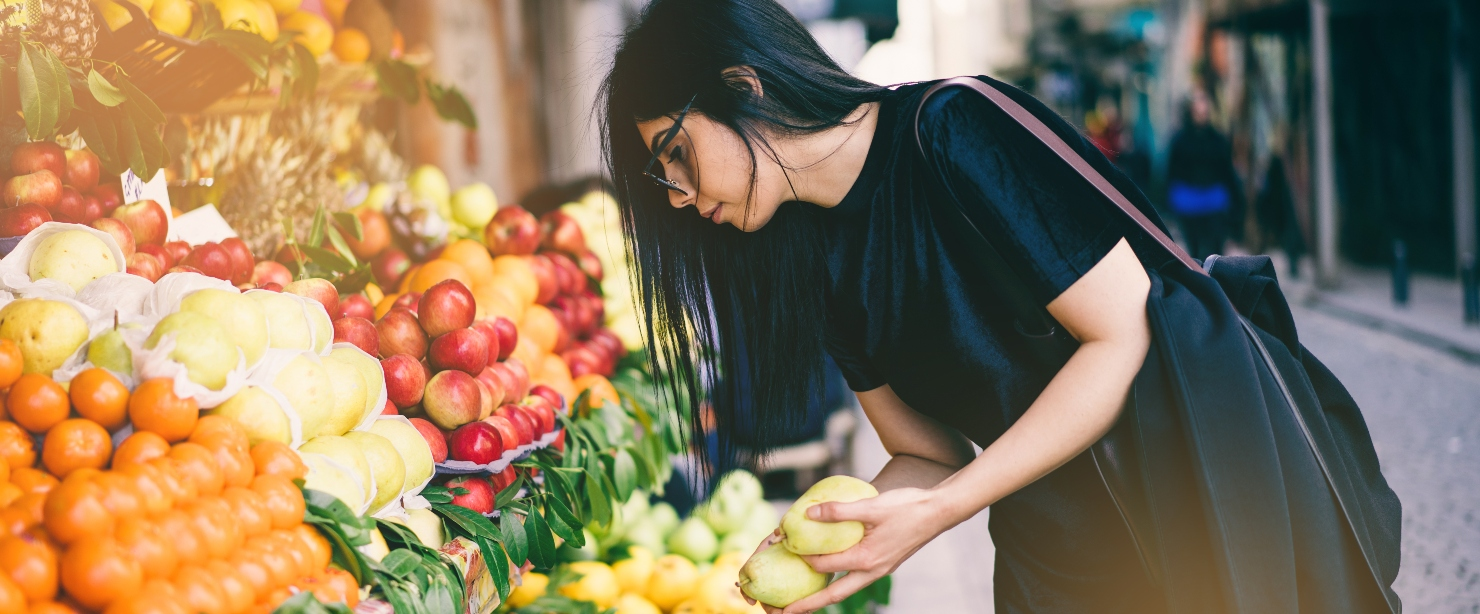 eat the rainbow: woman buying fruit at street stand