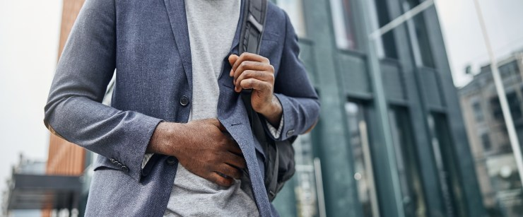 SIBO: man going to work holding stomach