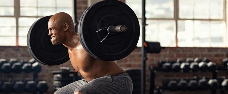 man squatting barbell