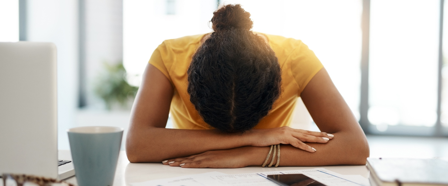 zapping your energy: woman tired at desk