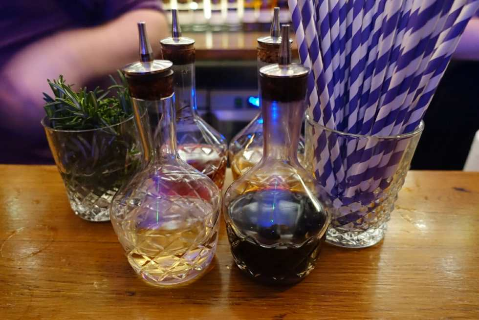 Bitters bottles lined up on the bar