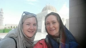 Katie and friend wearing headscarves outside the Grand Mosque