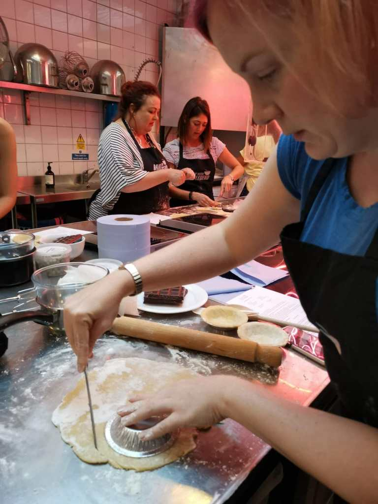 Katie cutting out pastry for the tins