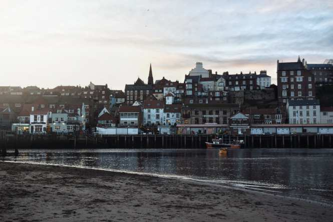 Whitby Harbour at sunset, North Yorkshire coast. One of the most beautiful villages in North Yorkshire.