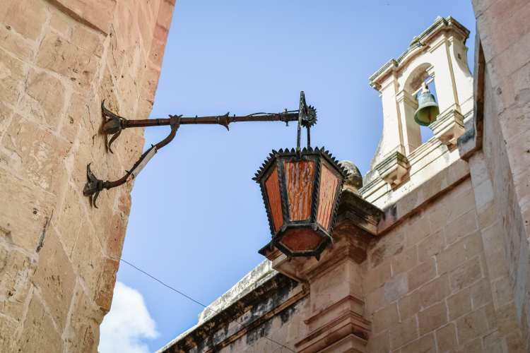 The Top Three Places In Malta That You Need To Visit. Street light in the silent city of Mdina, Malta.