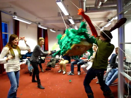 The slaying of a dragon piñata at the live finale of a social game
