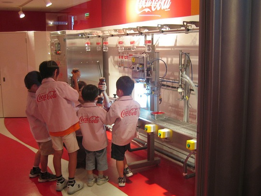 Children playing at working in a Coca-Cola factory in KidZania