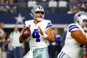 (AP Photo/Michael Ainsworth). Dallas Cowboys quarterback Dak Prescott (4) looks to throw against the New York Giants during the first half of an NFL football game in Arlington, Texas, Sunday, Sept. 16, 2018.