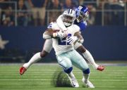 (AP Photo/Ron Jenkins). Dallas Cowboys running back Ezekiel Elliott, front, is stopped by New York Giants defensive back Landon Collins, rear, during the first half of an NFL football game in Arlington, Texas, Sunday, Sept. 16, 2018.